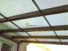 Pultová pergola ke zdi s 10 mm čirým komůrkovým polykarbonátem.